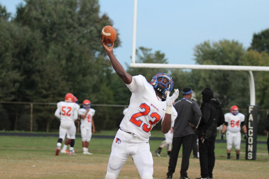 Senior  Devio'N Bridges catches a pass against the Poolesville Falcons on October 19.  Watkins Mill's athletes confirmed that hazing is not tolerated at Watkins Mill.