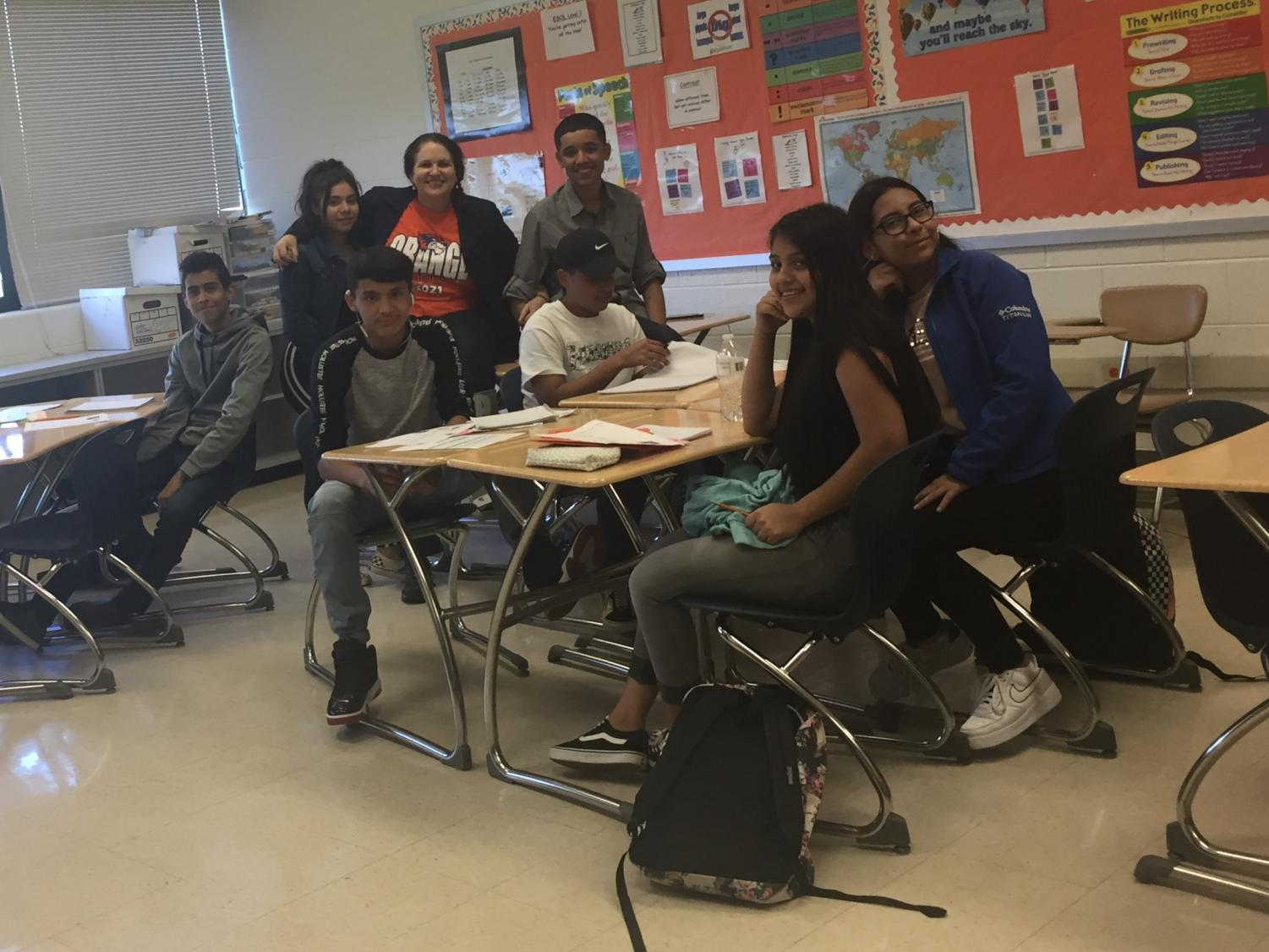 Students pose with ESOL teacher Sharon Faber in her ESOL 3 class