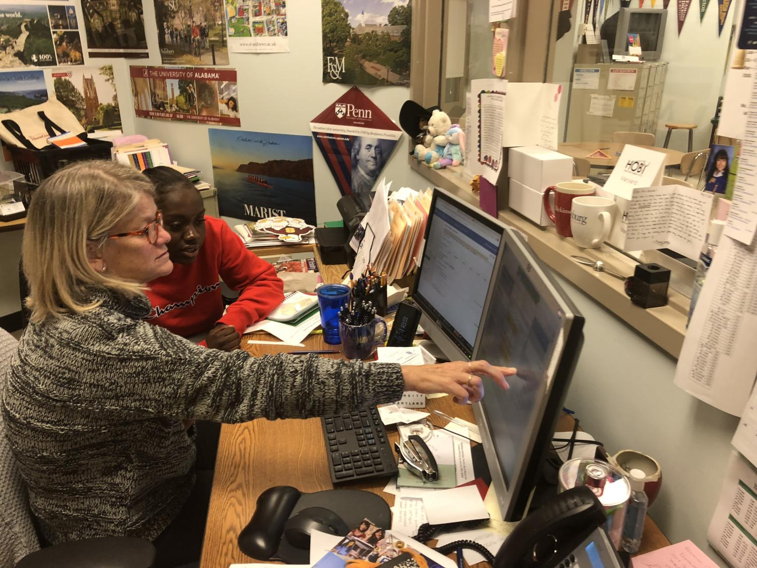 Senior Janice working with Career/Center Information Coordinator Kate Heald on the college application process.