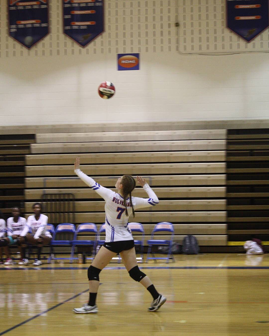 Junior Jade Pinkowitz serves in Monday's game