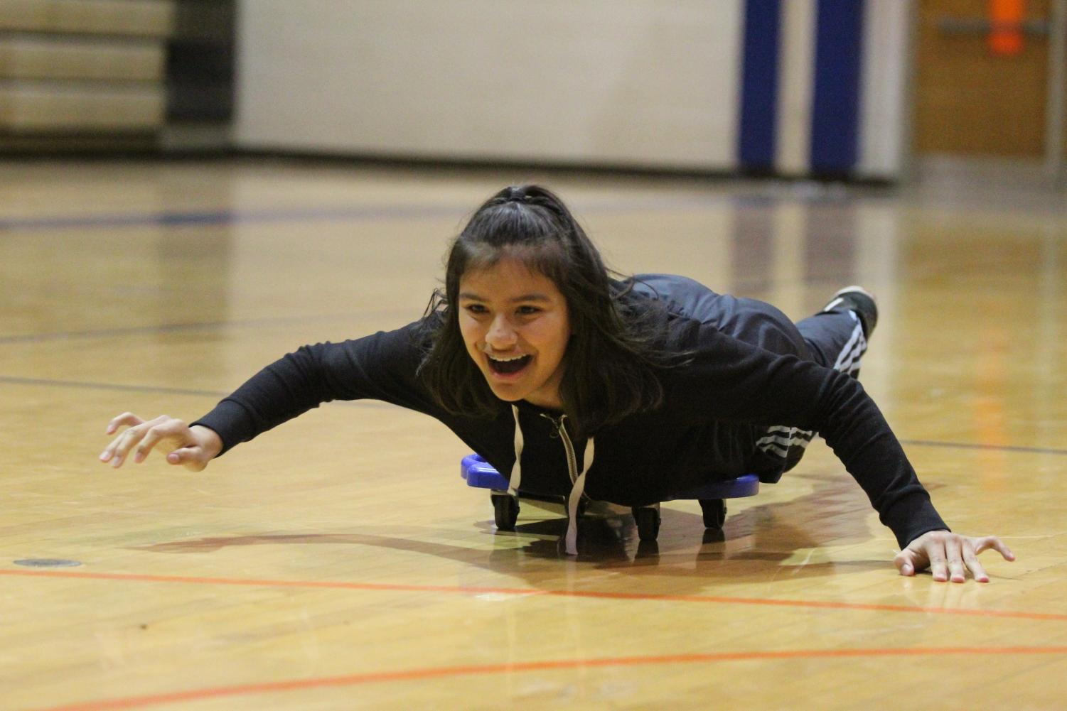 A student laughs as she races towards the finish line
