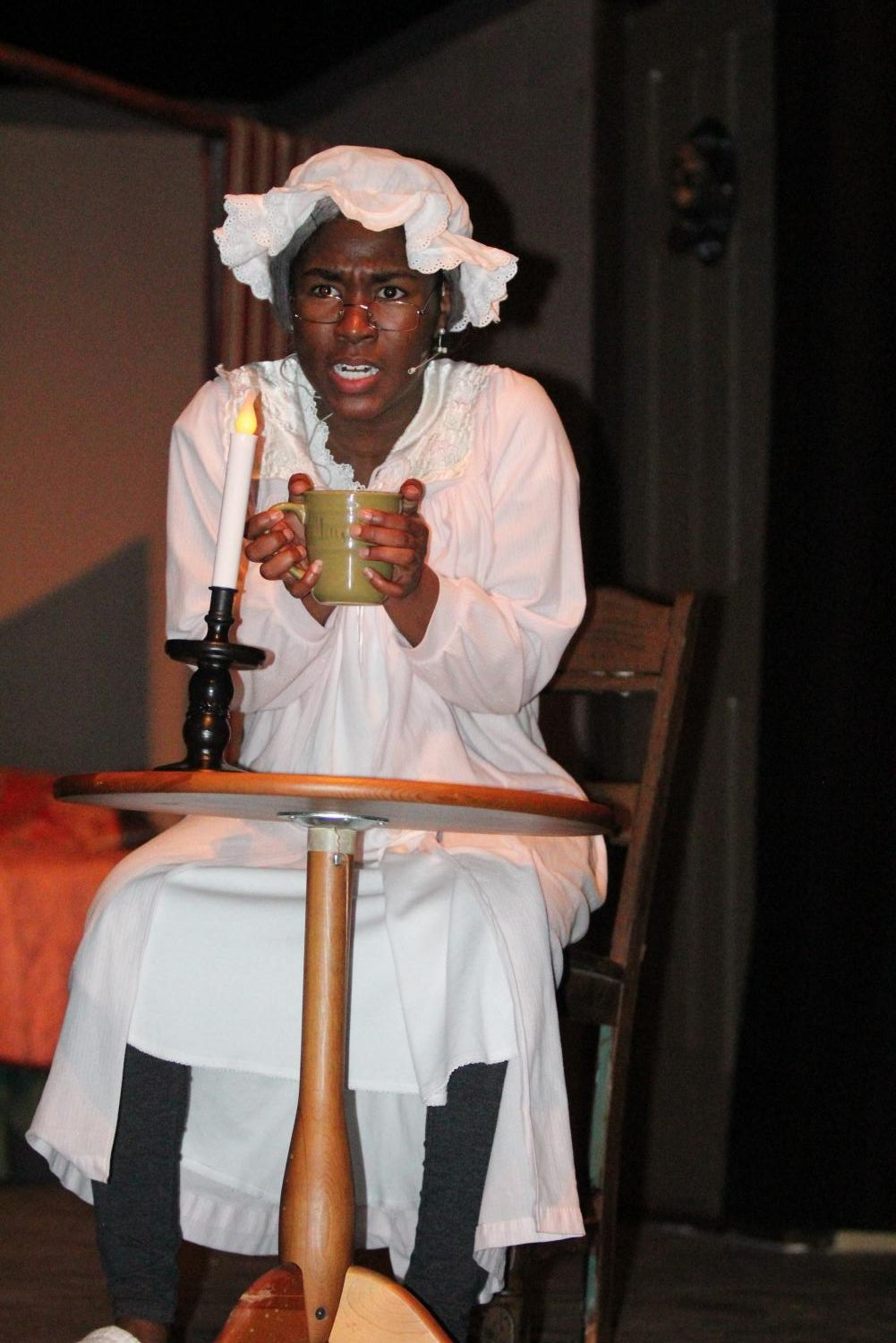 Bahumbug! Junior Taylor Leonard as Elizabeth Scrooge in dress rehearsal for A Christmas Carol