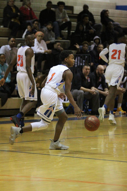 'Rines basketball won the season opener on December 7