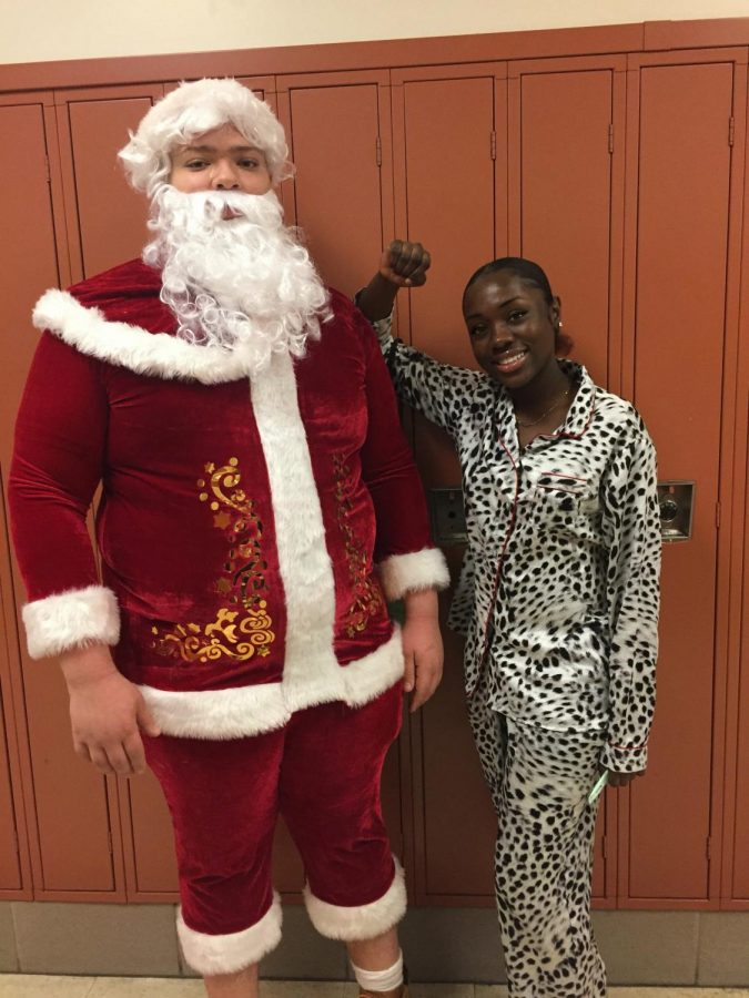 Senior+Janice+Asabere+takes+her+first+ever+picture+with+Santa.