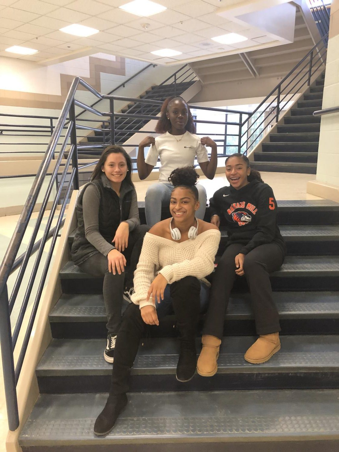 Senior Janice Asabere with dominant female athletes. From right to left, senior Ana Rodriguez, senior Yesenia Albright, and sophomore Jaden Gaboton