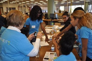 Volunteers+are+helping+students+make+collages+that+represent+student%27s+futures.+