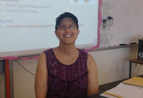 Science teacher soldiers on at school while battling breast cancer