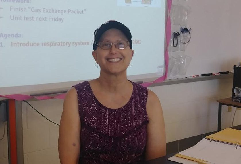 IB Biology teacher Lauren Wilkinson comes to work every day as she fights off Stage IIA breast cancer.