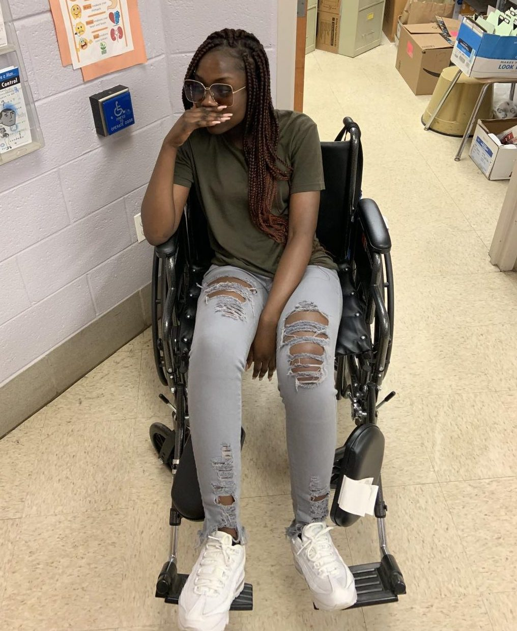 Janice Asabere in a wheelchair after being severely affected by senioritis