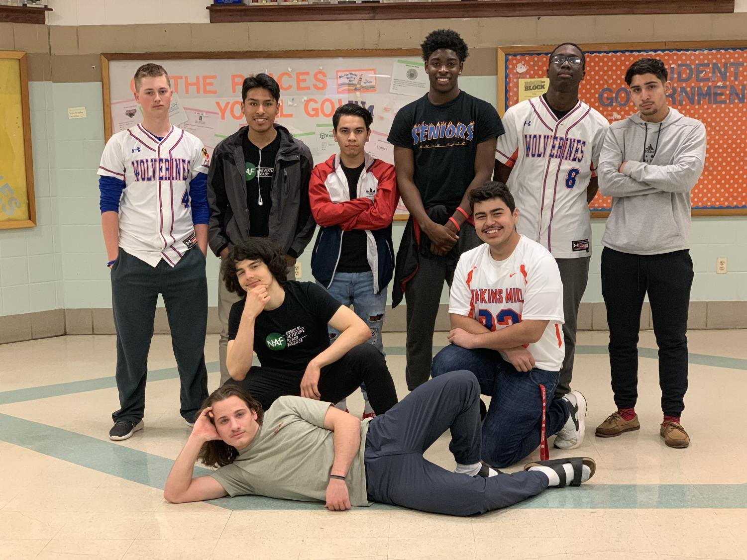 Male contestants for Mr. Watkins Mill pose for a group picture.