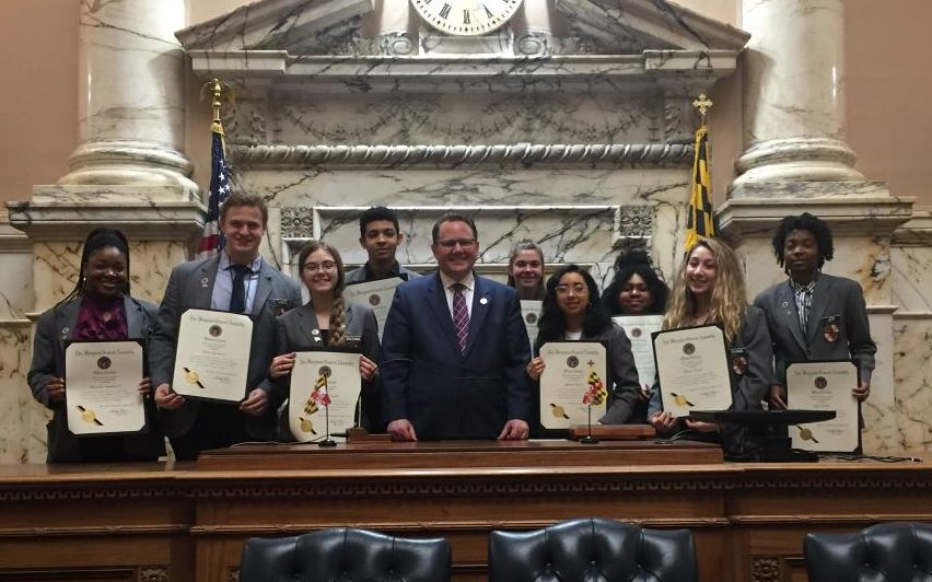 Senior Khava Tsarni (second from right) receives a proclamation along with other pages from Maryland General Assembly House minority leader Nicholaus Kipke