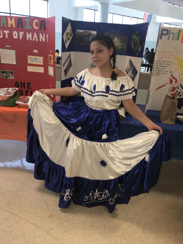 Senior Doereana Hernandez Martinez shows off her dress at International Night on March 14.