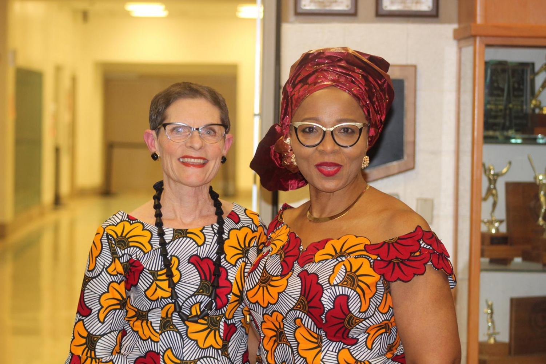 Principal Carol Goddard and math teacher Taiwo Okusaga wearing matching prints as the Watkins Mill ASA.