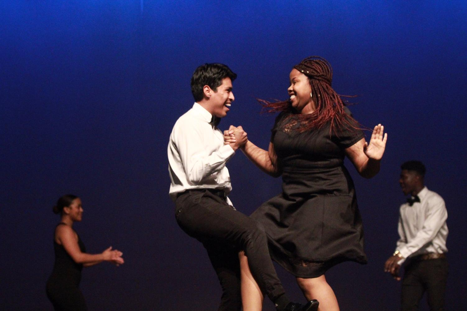 Seniors Joseph Alminagor and Sandra Ogbuokiri dance during the opening scene of the Mr. Watkins Mill contest.