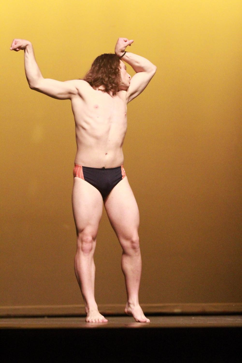 Senior+Brennan+Guilds+showing+off+his+swimmer-bod+during+the+swimsuit+portion+of+the+Mr.+Watkins+Mill+contest.
