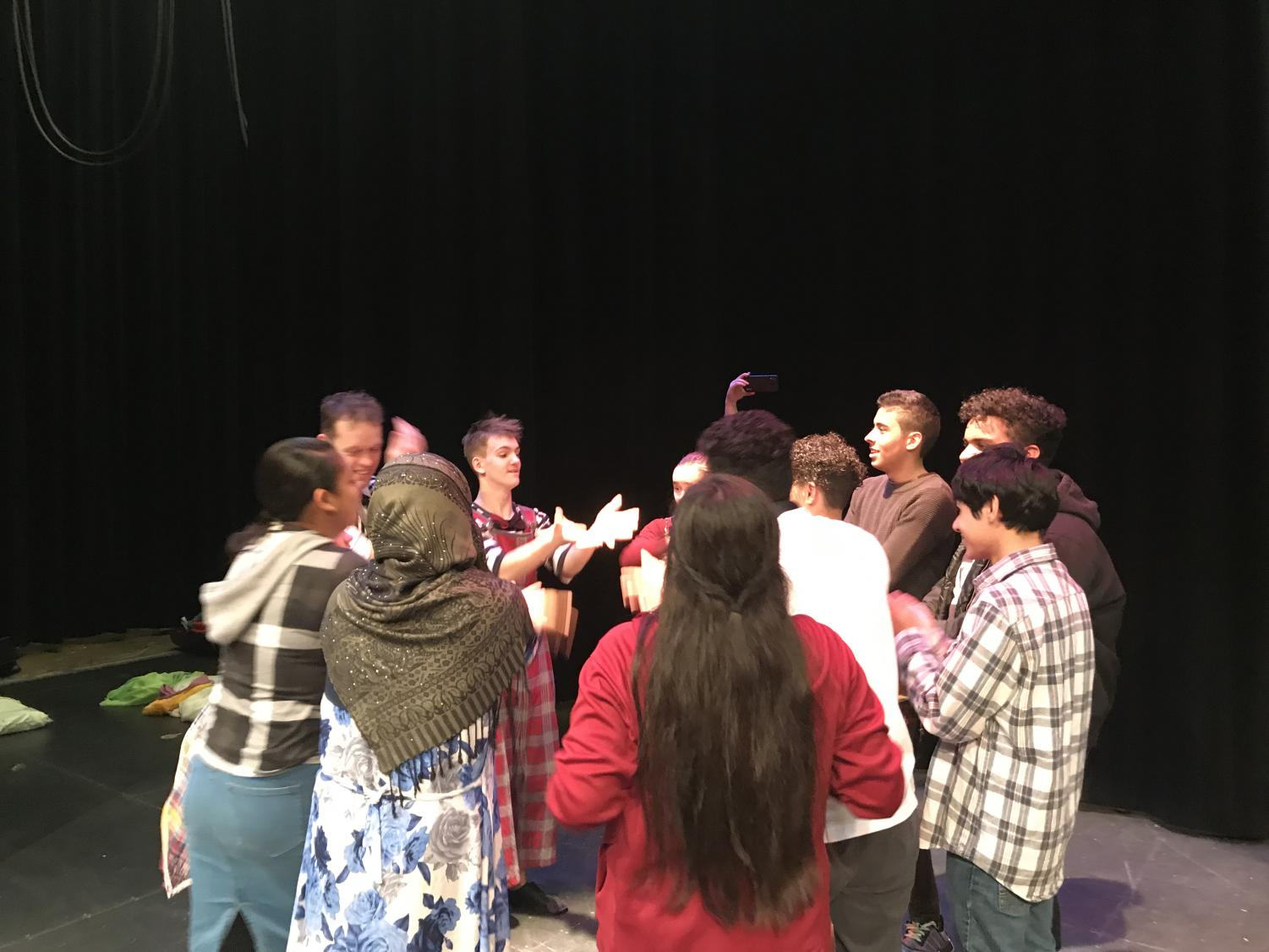 ESOL+theatre+students+participate+in+a+workshop.