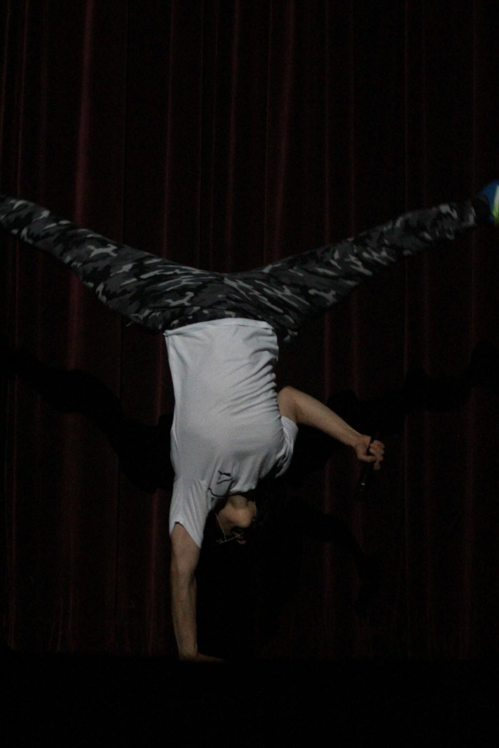 Senior+and+contestant+Phillip+Kostin+does+a+cartwheel+after+his+motivational+speech-turned+rap+during+the+talent+portion+of+the+Mr.+Watkins+Mill+contest.+
