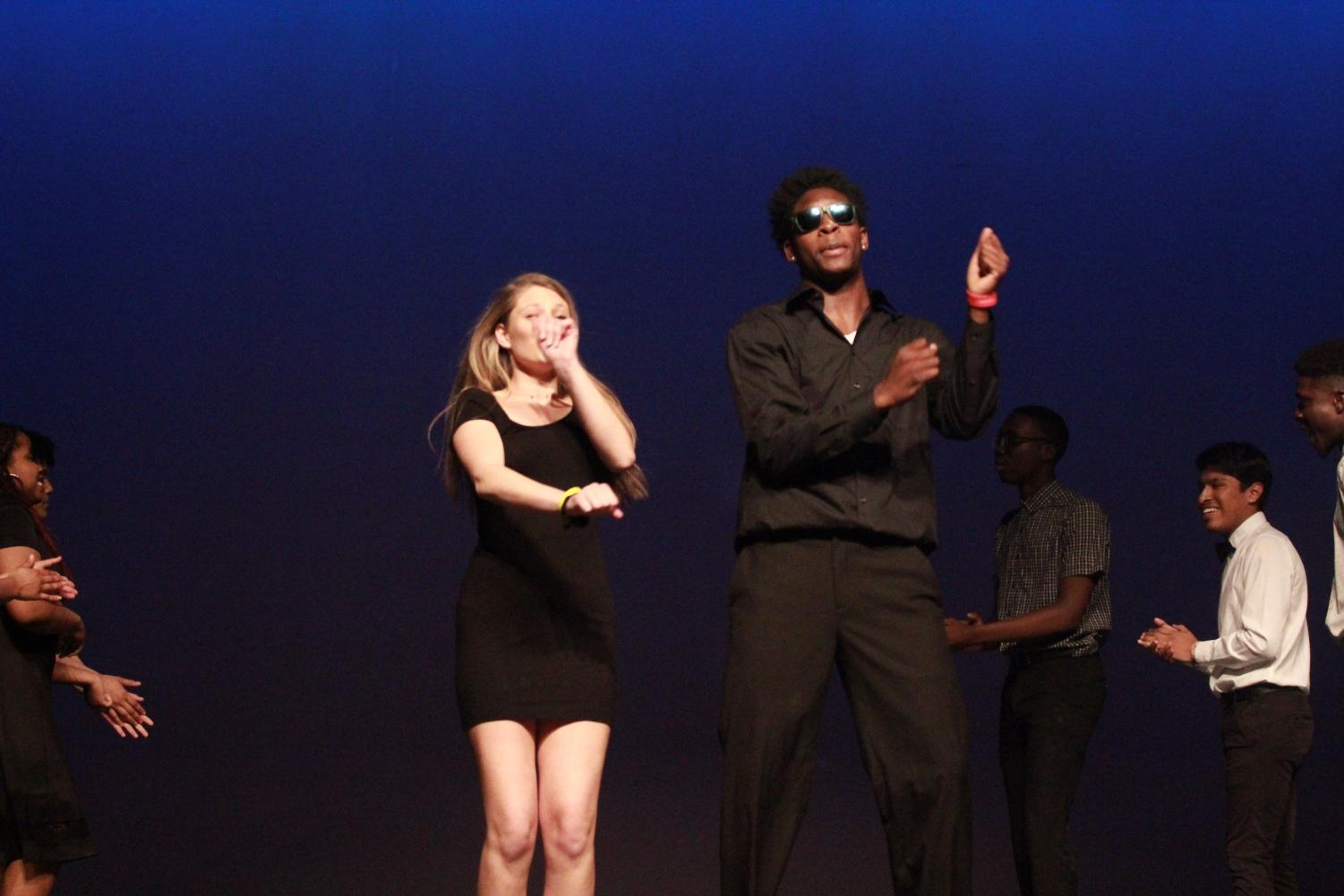 Seniors+Taylor+Dawson+and+Devion+Bridges+hit+%22The+Woah%22+during+the+opening+performance+of+Mr.+Watkins+Mill.