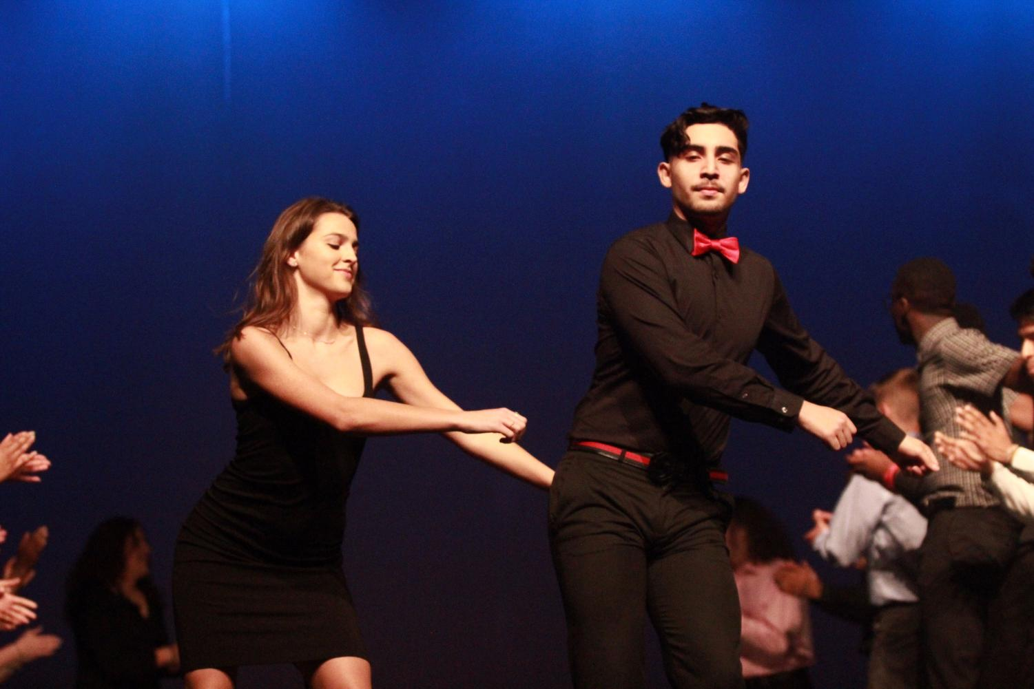 Seniors+Isai+Flores+and+Annie+Riley+hit+%22The+Floss%22+during+the+opening+performance+during+Mr.+Watkins+Mill.