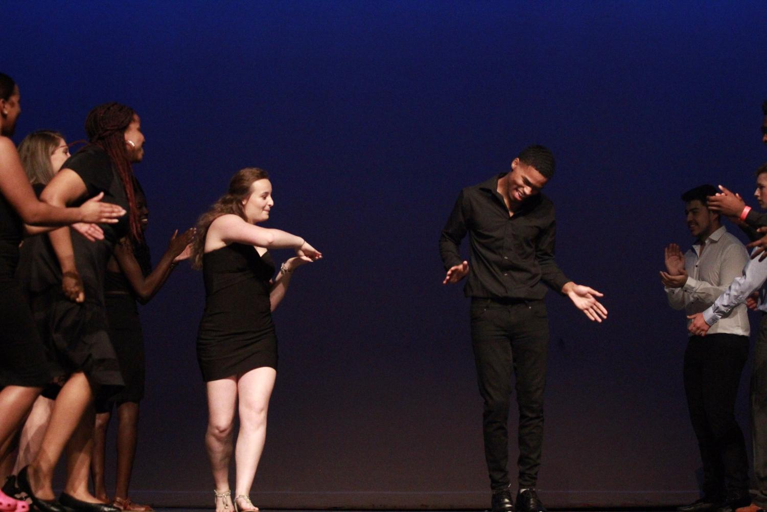 Senior+Lauren+Flandrau+and+Dejion+Martin+dancing+their+way+down+the+stage+during+the+introduction+group+dace+of+Mr.+Watkins+Mill.
