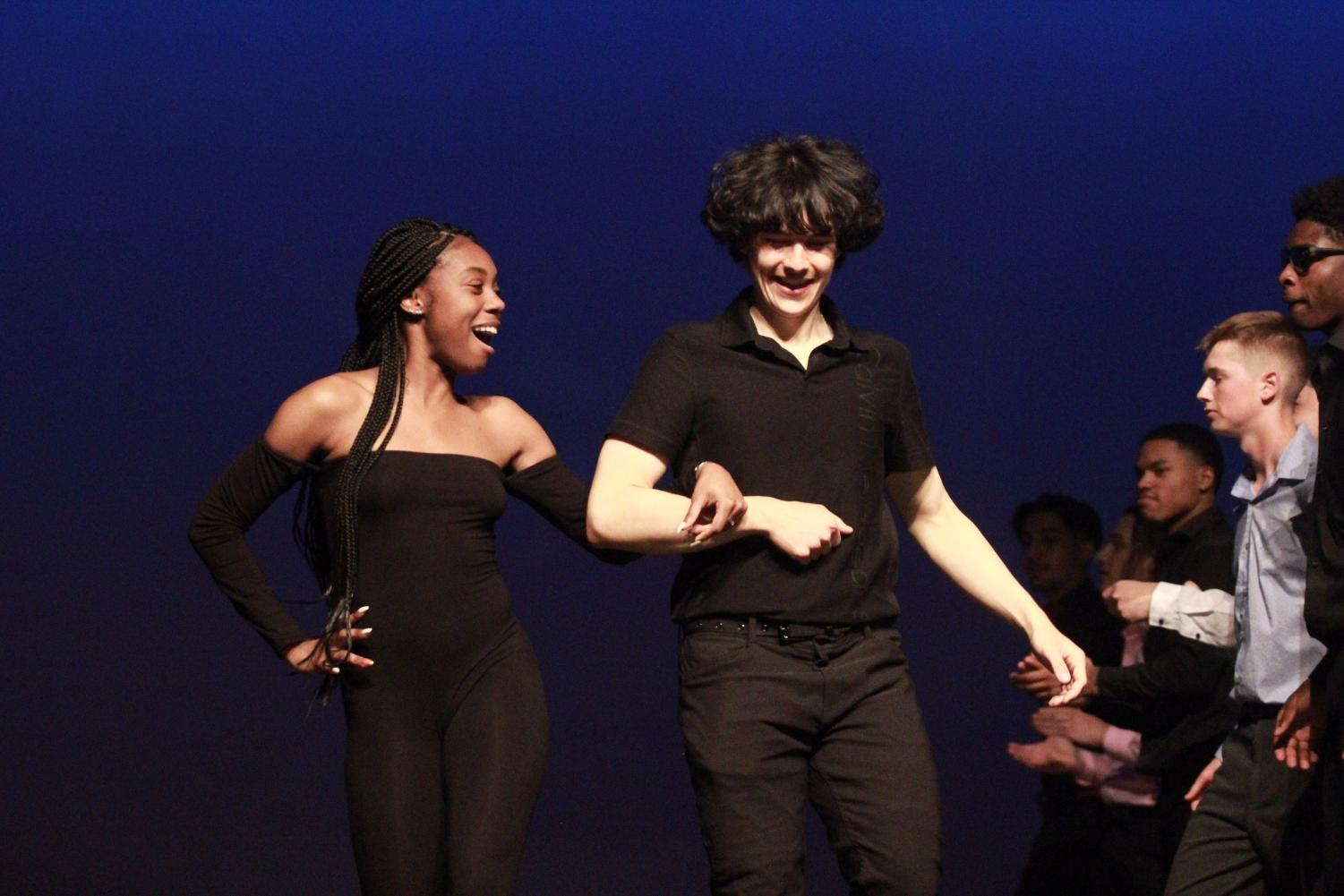 Seniors+Phillip+Kostin+and+his+escort+A%27Shanti+Roger+dance+during+the+opening+performance+during+the+Mr.+Watkins+Mill+Contest.