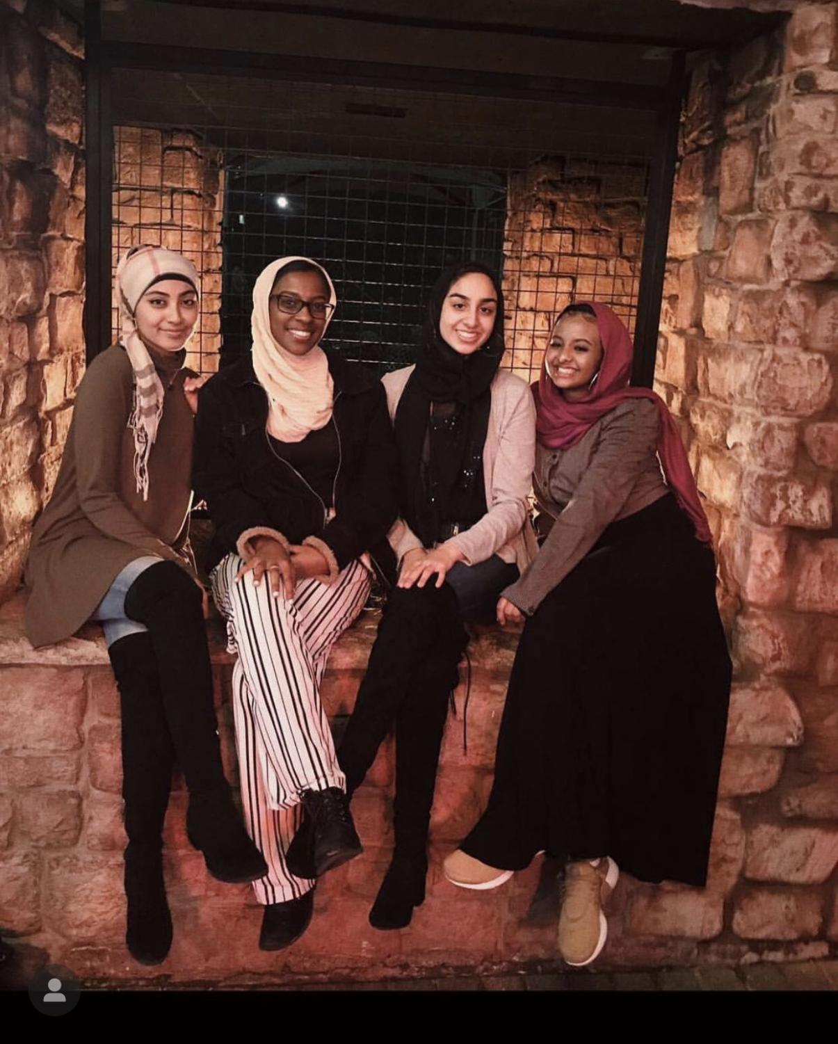 Senior Sana Khan wears her hijab proudly with her friends, Khusna Rachman, Islah Abdulmalek and Lena Elamin, despite the curious questions that she gets daily.