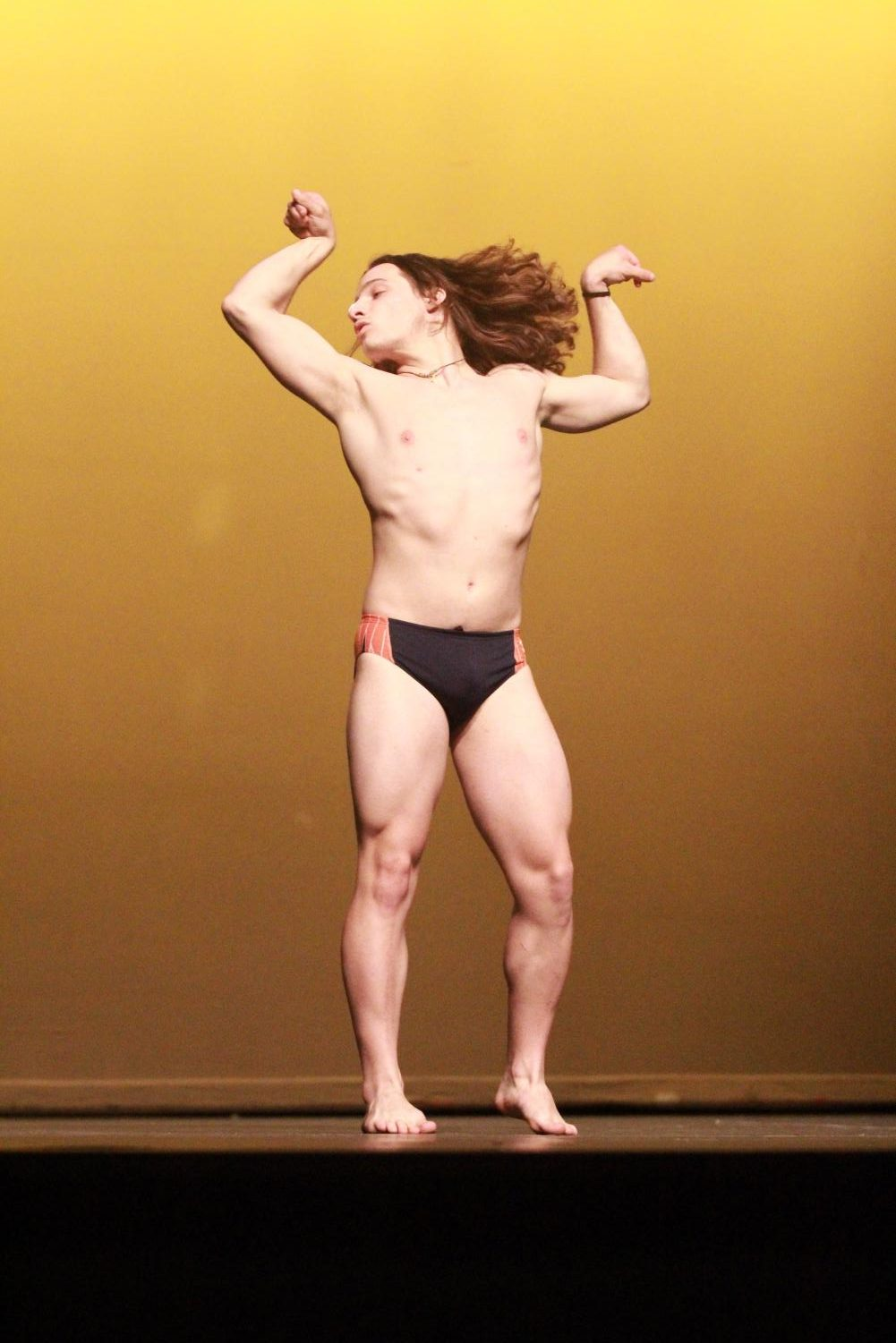 Senior+Brennan+Guilds+showing+off+his+luscious+locks+and+swimmer-bod+during+the+swimsuit+portion+of+the+Mr.+Watkins+Mill+contest.
