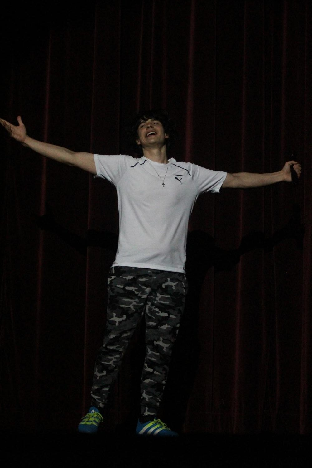 Senior+and+contestant+Phillip+Kostin+performs+a+motivational+speech-turned+rap+during+the+talent+portion+of+the+Mr.+Watkins+Mill+contest.+