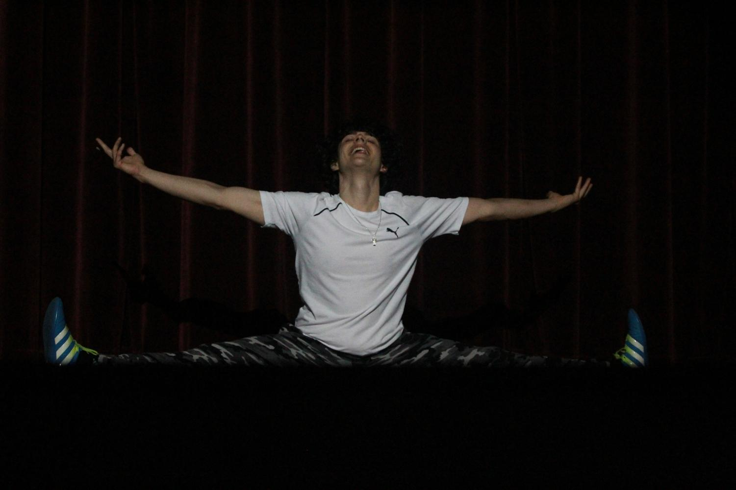 Senior+and+contestant+Phillip+Kostin+does+the+splits+after+his+motivational+speech-turned+rap+during+the+talent+portion+of+the+Mr.+Watkins+Mill+contest.+