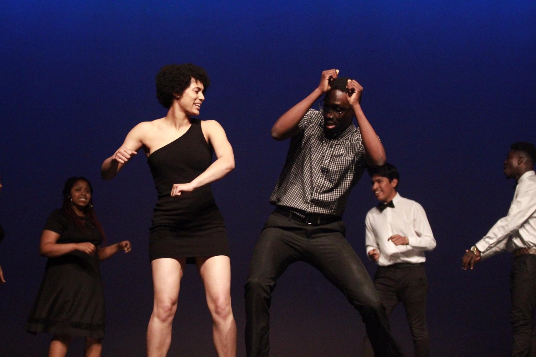 Seniors+Jamie+Carmichael+and+Joseph+Kamara+dance+during+the+opening+scene+of+the+Mr.+Watkins+Mill+contest.+