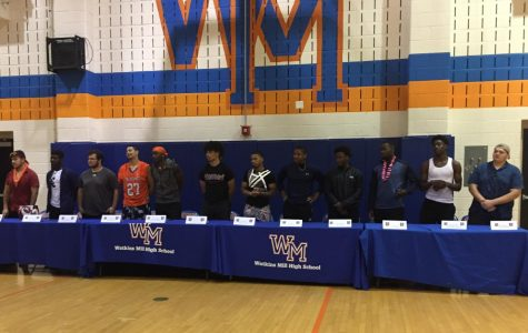 Senior athletes commit to colleges to continue sports careers