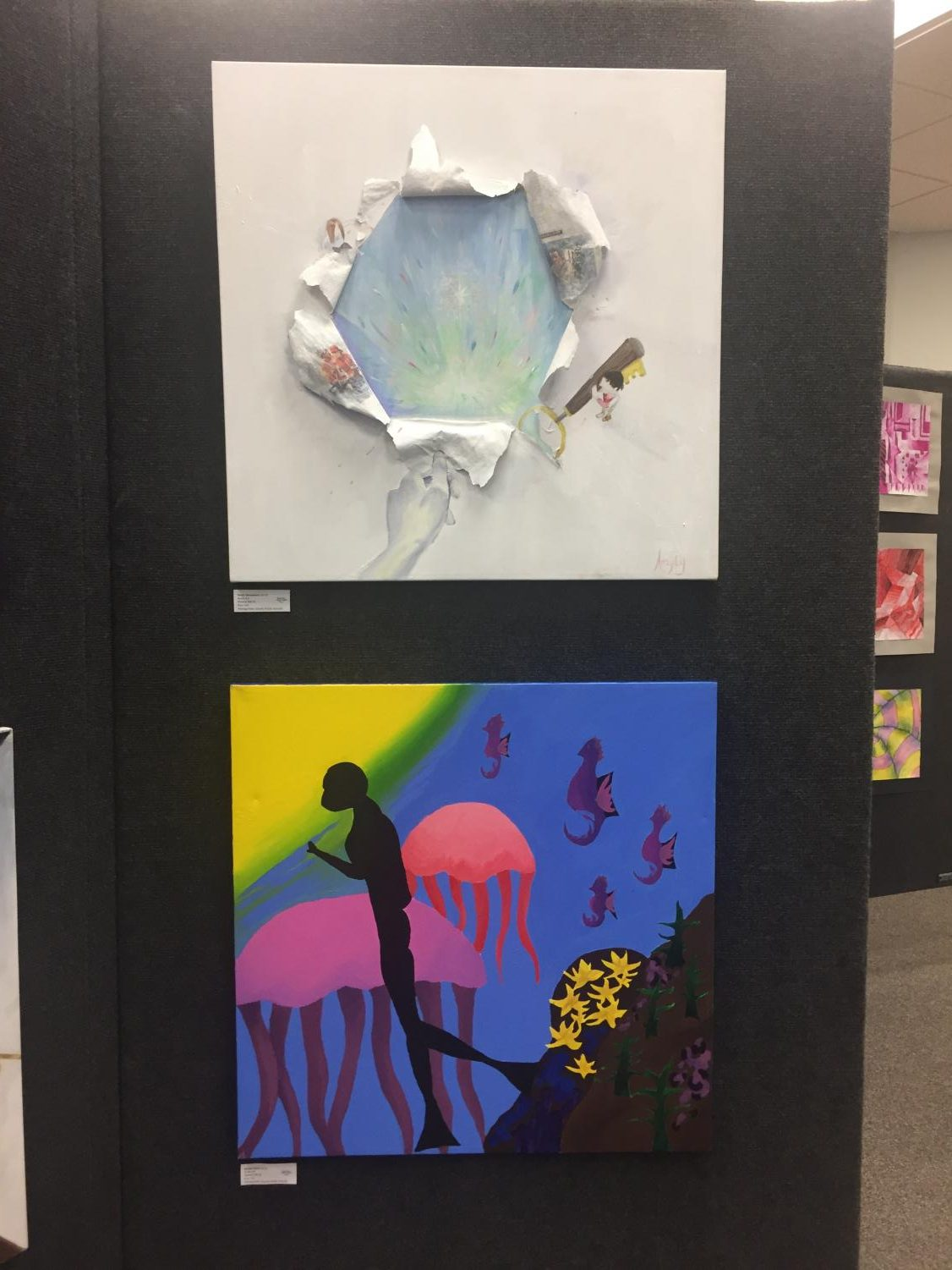 Painting+by+Junior+Natalie+Helsel+of+an+underwater+diver+%28bottom%29+and+Artwork+by+Sophomore+Tanya+Yahouedeou+of+a+hole+ripped+in+a+canvas+to+show+a+colorful+painting+%28top%29+in+the+Watkins+Mill+High+School+Art+Show+2019