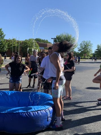 Seniors spend last day in style, host BBQ with bounce house, water slide