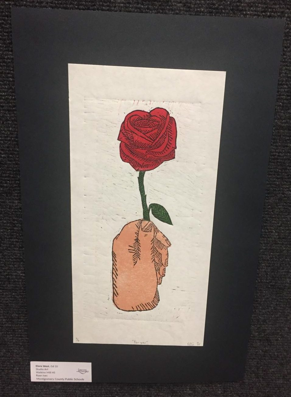 Artwork+by+Sophomore+Elora+West+of+a+hand+and+rose+in+the+Watkins+Mill+High+School+Art+Show+2019