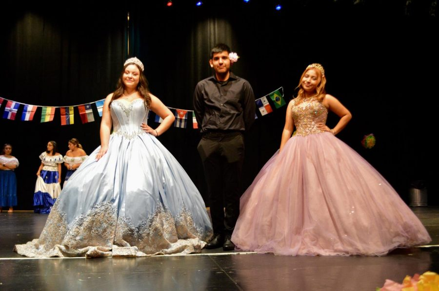 Sophomore Briana Mendez, junior Alfonso Zavala, and sophomore Karen Zelaya pose in their quinceañera attire.