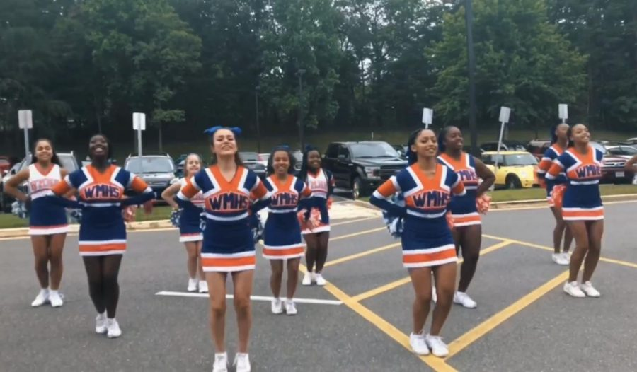 Junior varsity cheerleaders perform at the STEP rally to prepare for the beginning of the sports season