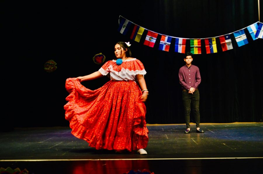 Senior+Kathleen+Cantarero+dancing+in+her+cultural+attire+at+the+Hispanic+Heritage+Month+assembly.