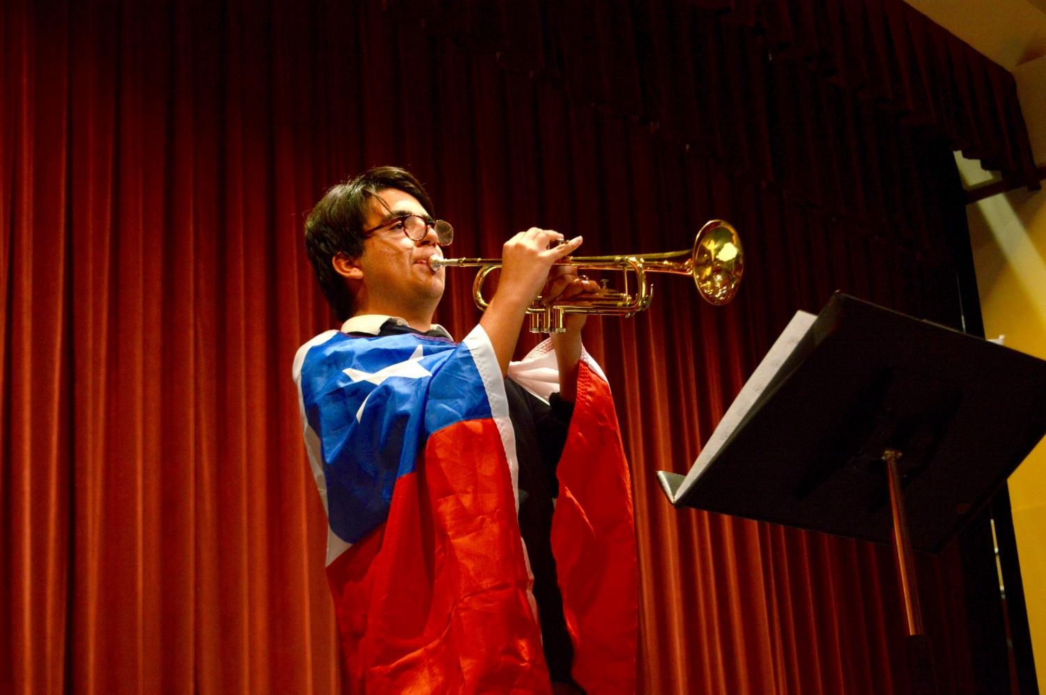 Sophomore+Mauro+Gonzalez+plays+the+trumpet+and+shows+off+the+Chilean+flag.