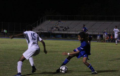 Junior Carlos Cordona dribbles the ball past a Springbrook player.