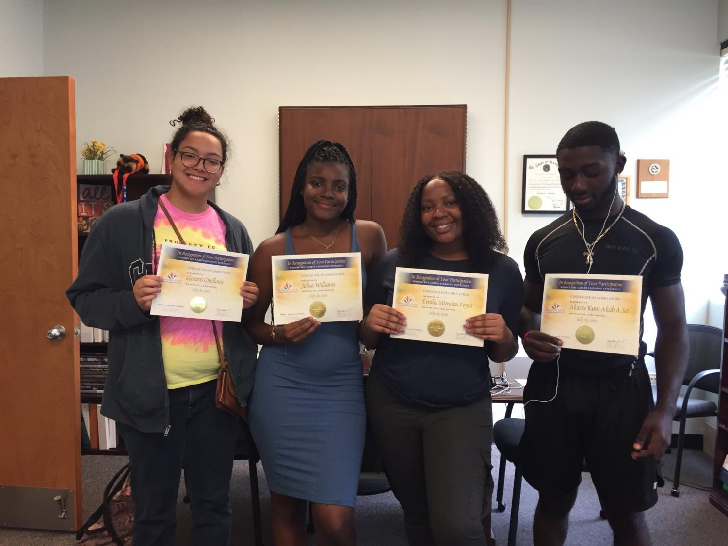 Students holding up their Summer RISE Program certificate after completing the program.