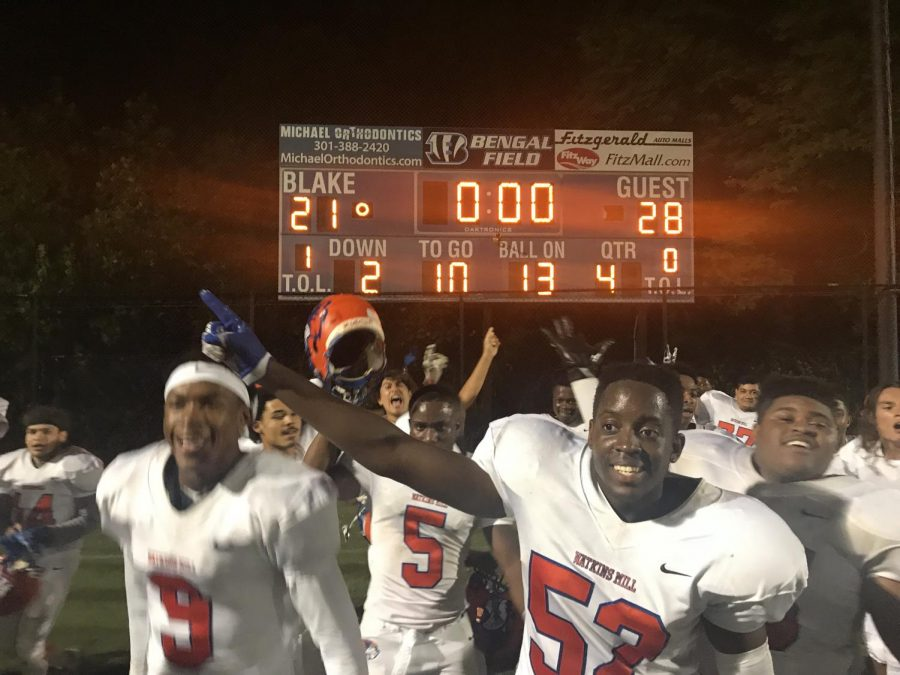 The Watkins Mill High School football team celebrate their win against Blake High School after losing in the previous year.