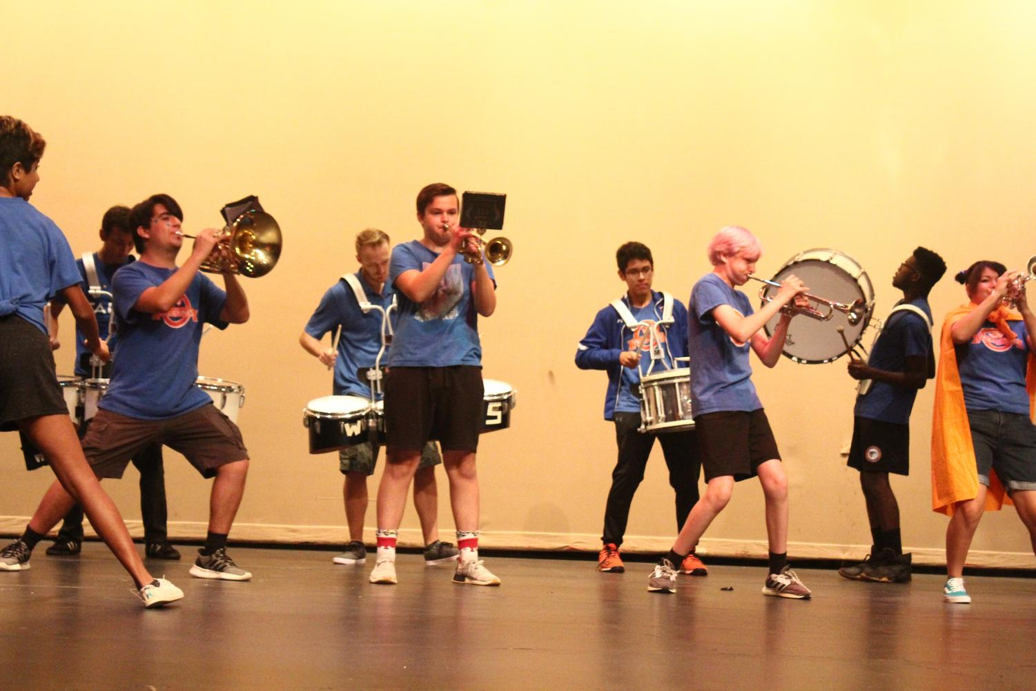 The+marching+band+and+drumline+perform+for+the+new+students.