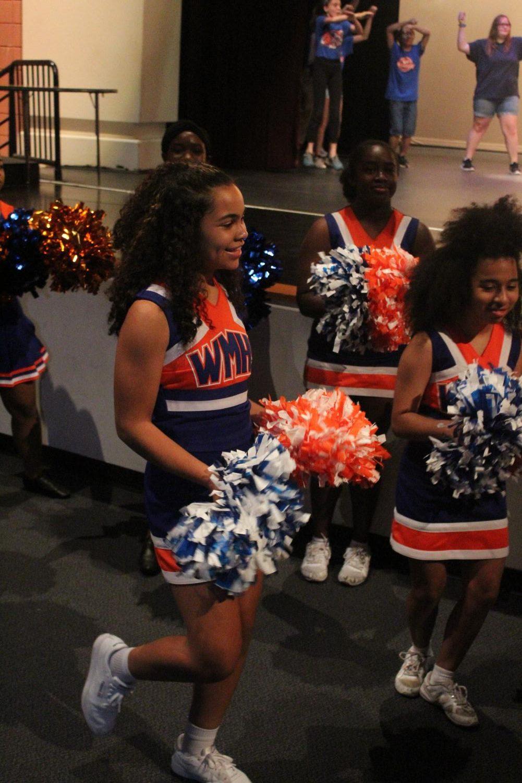 Freshman+Ciara+Johnson+joins+her+fellow+cheerleaders+in+welcoming+students.