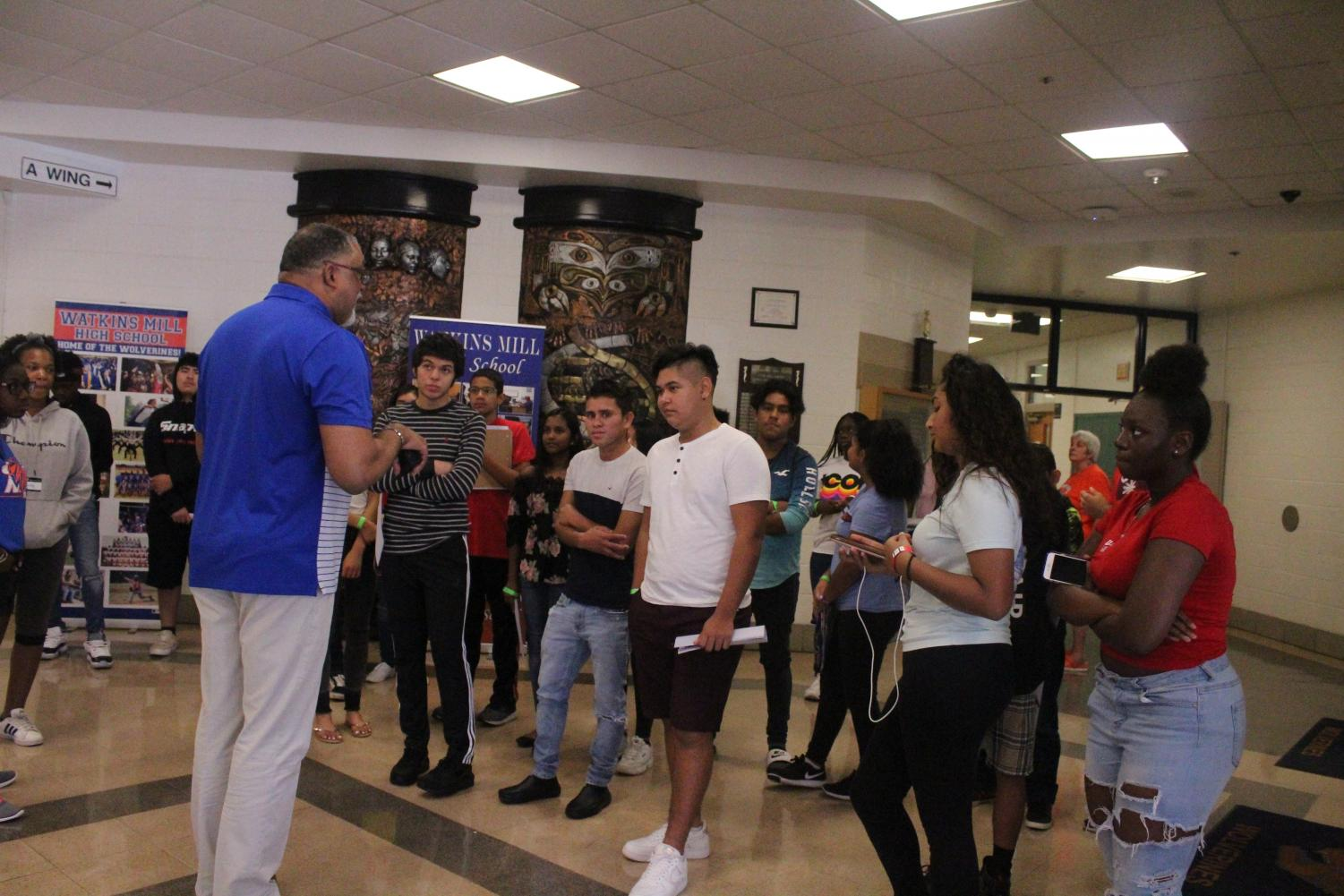 Assistant Principal Eric Jackson introduces himself to a group of new students.