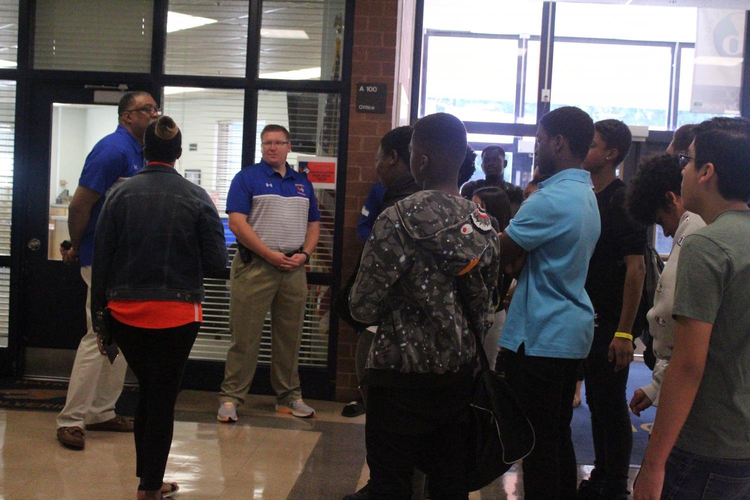Assistant+principals+Eric+Jackson+and+Ryan+Graves+speak+to+incoming+students.