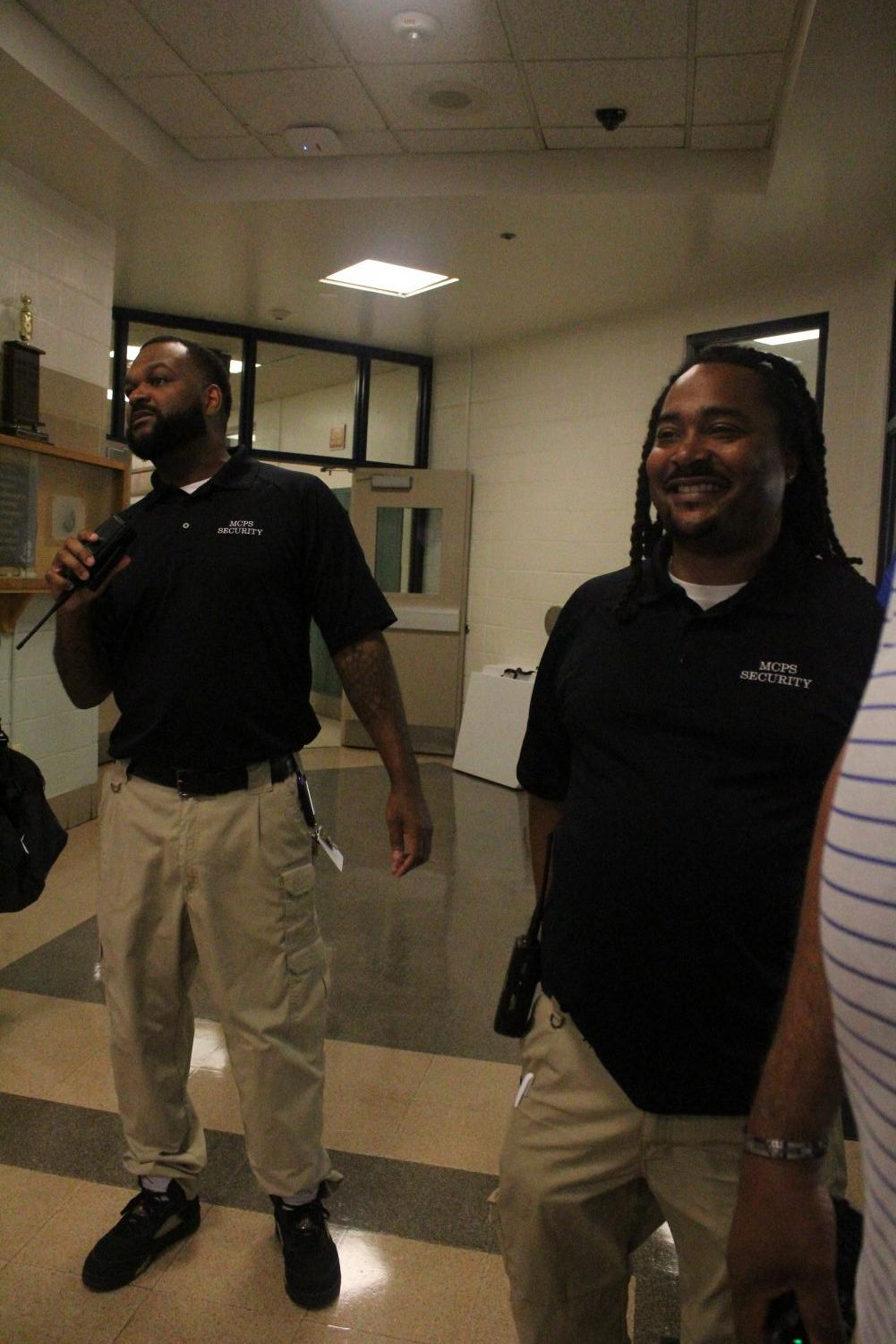 Security+officers+Camonte+Lee+and+Aron+Dorsey+introduce+themselves+to+new+students.