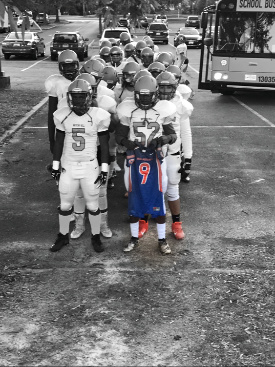 The Watkins Mill High School football team dedicates their win against Magruder High School to alumni football player Daquan (DayDay) Wims who passed away recently.
