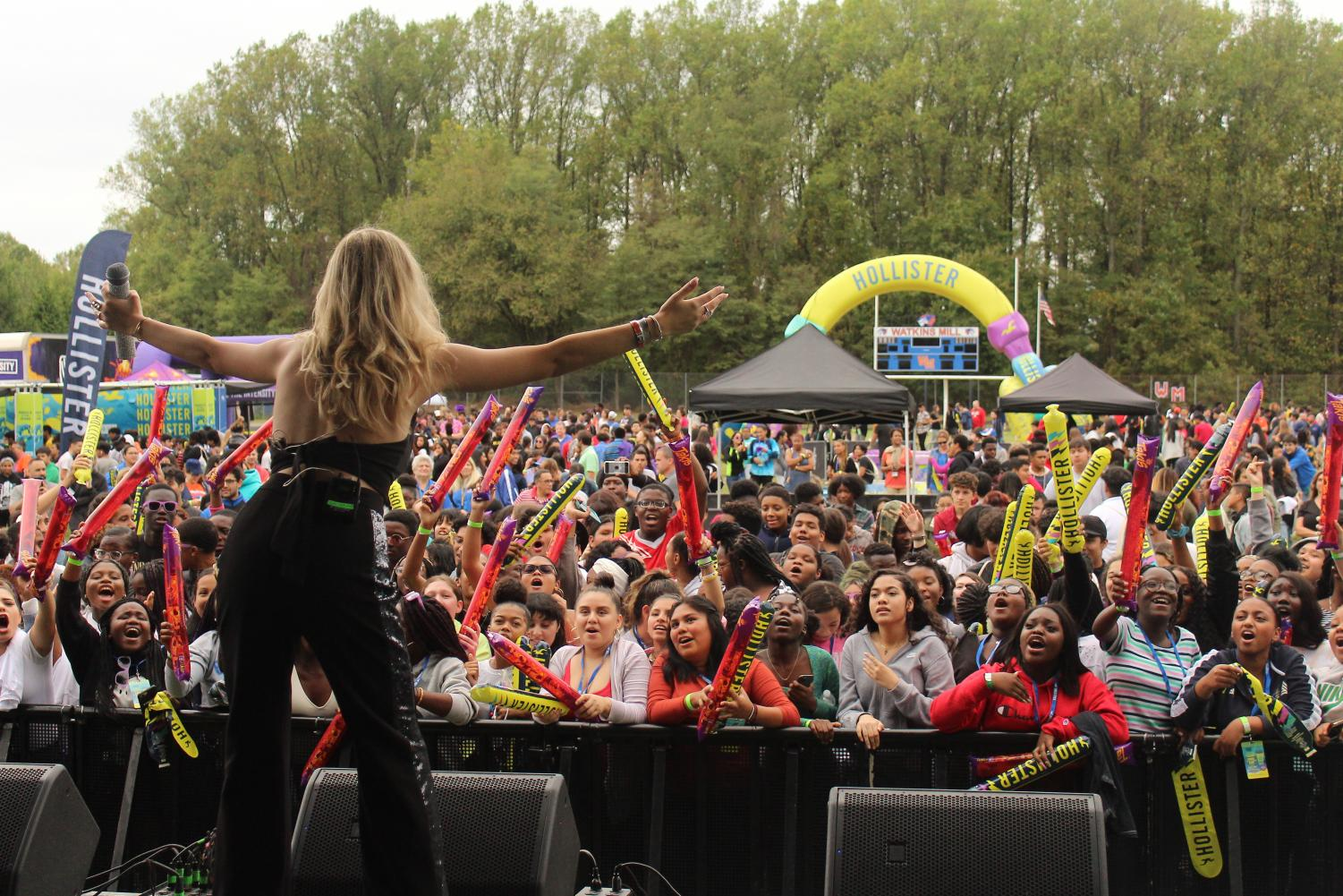 Sofi K embraces her fans during the High School Nation music and arts festival at Watkins Mill High School.