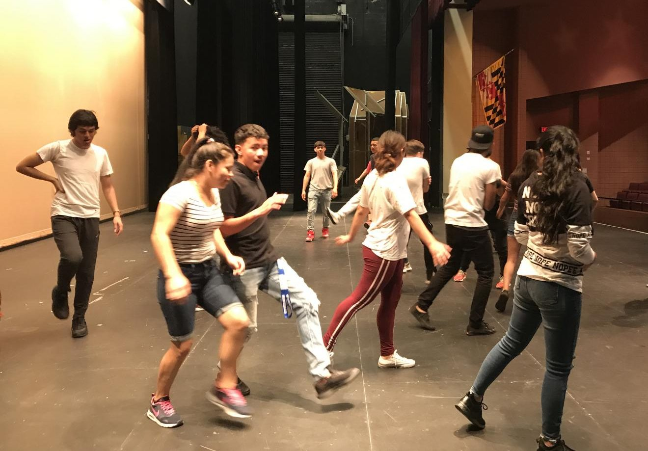 ESOL Theatre students learn movement exercises from members of the Olney Theatre Center