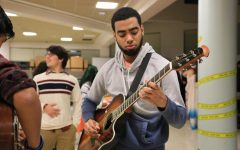 Alumni Xavier Lagual shows his skills with the guitar